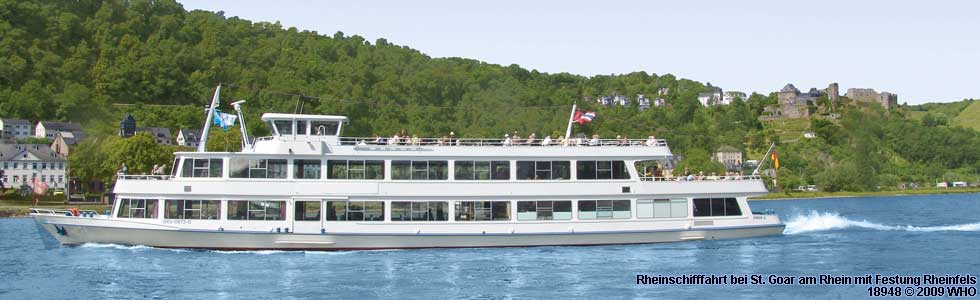 Germany Tourism, Rhine River day boat cruise near St. Goar with castle Rheinfels.